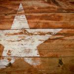 a Texas star symbol on wood