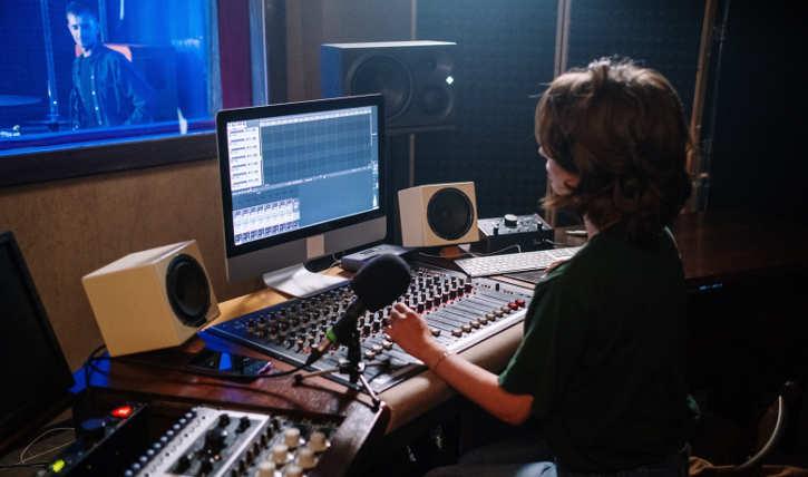 woman at a mixing board