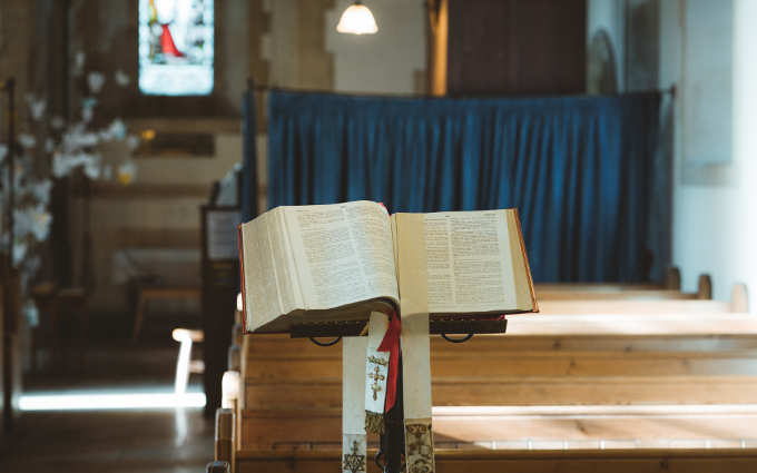 a bible on a stand in church