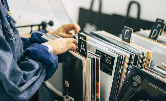 woman looking through record albums