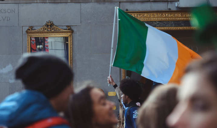 group of people - man holding Irish flag