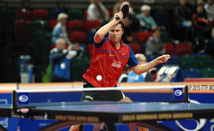 a man playing ping pong