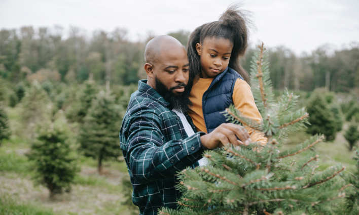 man holding his daughter outside