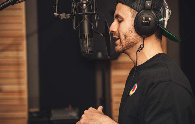 a man singing in a sound studio