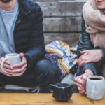 a man and woman drinking coffee together and chatting
