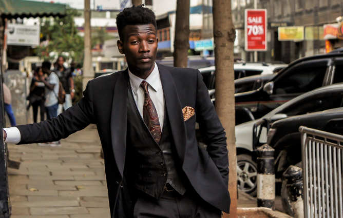 a man in a suit outside
